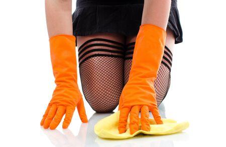 houseclean: Sexy girl in stockings cleaning floor on her knees -  isolated on white background