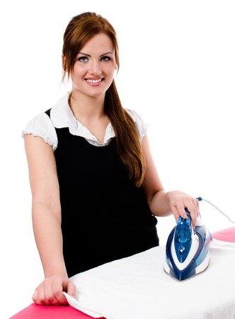 Happy smiling woman housewife ironing clothes -  isolated on white background photo