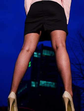 Sexy girl in high heels and stockings at night, office building in the background Stock Photo - 13563566