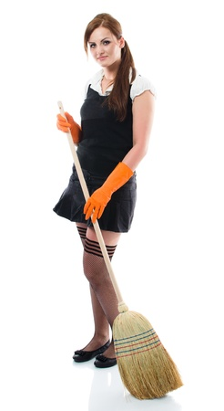 Young sexy woman sweeping the floor - isolated on white background Stock Photo - 13742288