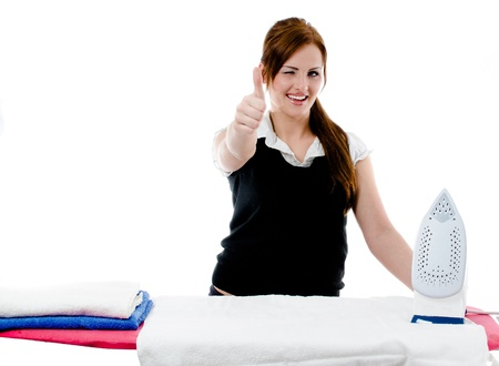 Beautiful girl irons colored towels on the ironing board - isolated on white background Stock Photo - 13742290