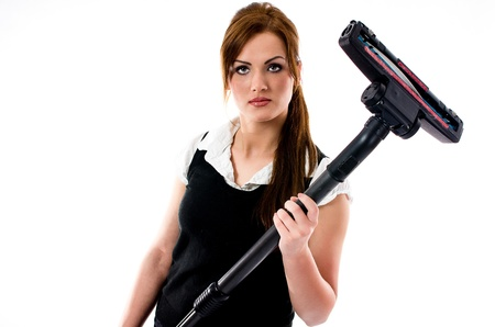 Beautiful brunette woman holding a vacuum cleaner - isolated Stock Photo