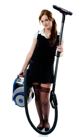 Beautiful brunette woman holding a vacuum cleaner - isolated on white photo