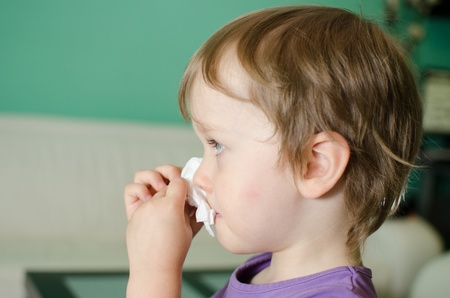 Cute kid cleaning his nose Stock Photo