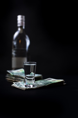 Money we spent on alcohol - black bacground photo