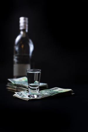 Money we spent on alcohol - black bacground Stock Photo