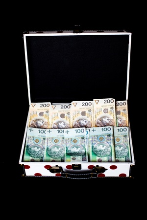 Big prize on lottery - Polish money in colorfull briefcase on black background photo
