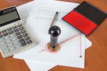 How much will the Notarial Service cost ? - Notary tools on desk