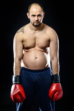 Funny resigned fat boxer isolated on black background photo