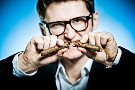 quiting smoking: Man in suit and glasses - breaking a cigar Stock Photo