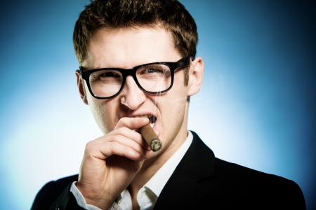 Man in glasses smoking cigar photo