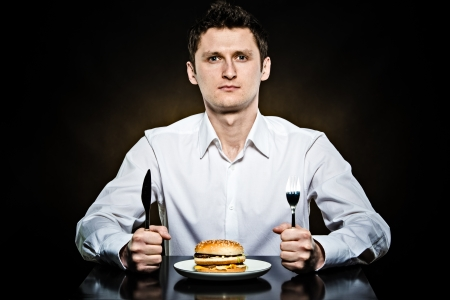 Hungry man in the white shirt is going to eat a burger photo