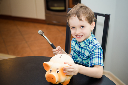 4 year old: 4 year old boy wants to break the piggy bank with a hammer