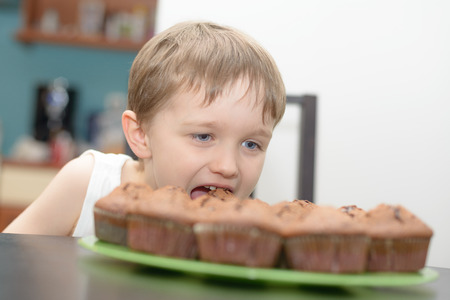 4 year old: 4 year old boy eats chocolate cake - muffin