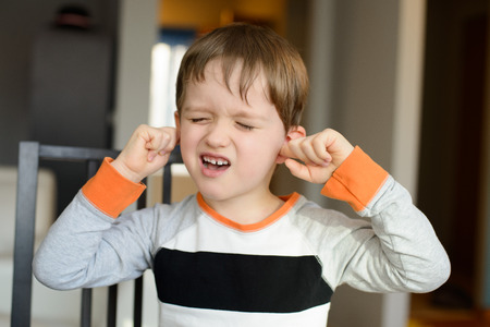 4 year old: 4 year old boy screaming and clog his ears with fingers at home
