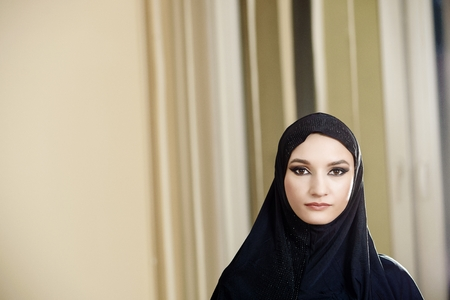 Portrait of a woman in a hijab while working in the office photo