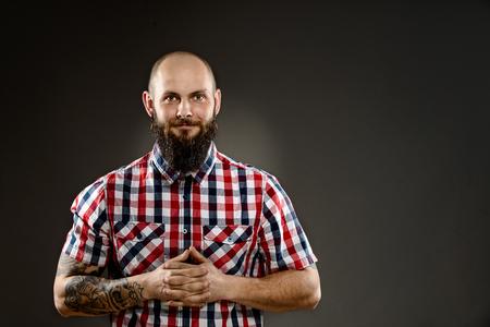 funny bearded man: Funny bearded man in shirt on grey background Stock Photo
