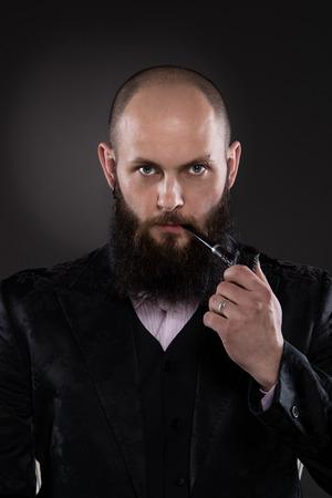 Retro stylized hipster with black beard - gray background photo