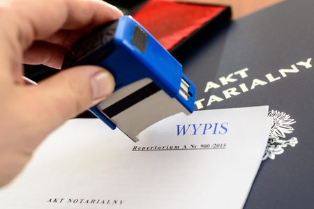 Notary gives stamp on notarial act Stock Photo