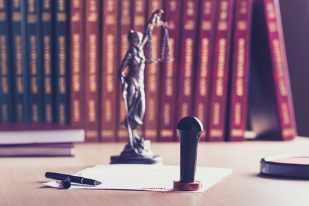 certifying: Stamp that is used by a notary public with his pen. Themis with scales of justice in the background