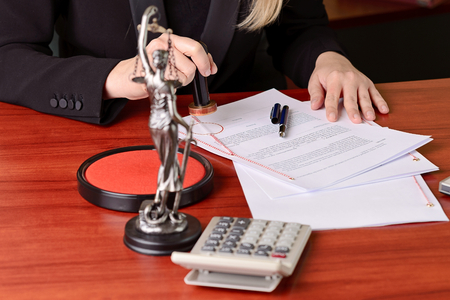 Notary public stamping the agreement on rosette in notary office Stock Photo