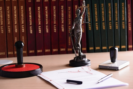 acts: Notary public accessories. Themis with scales of justice and notarial acts in the background.