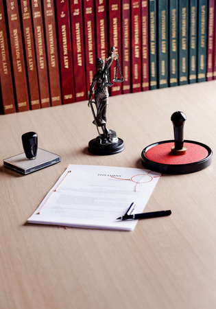 Signed last will on notary public desk. Notary public accessories