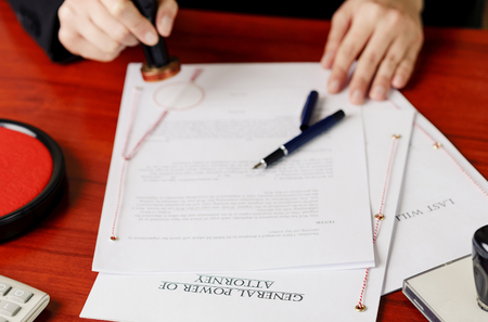 signing authority: Notarys public hands stamping power of attorney. Notary public accessories