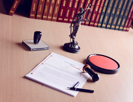 notary: Last will waiting for a notary public sign on desk. Notary public accessories