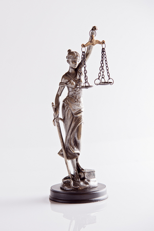 justness: Statue of Themis - goddess of justice on white background