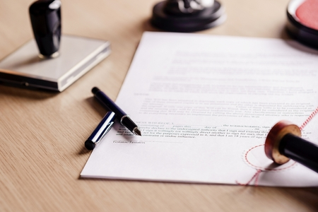 Notary pen lying on testament. Notary public working accesories Stock Photo - 51610355