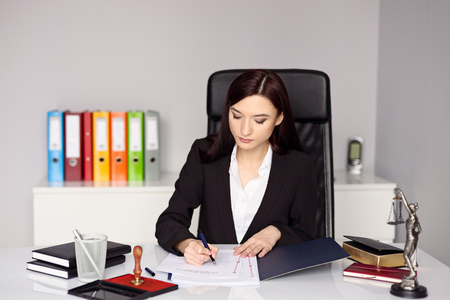 business letters: Woman notary public notarizes the power of attorney or other document . Notary public concept Stock Photo