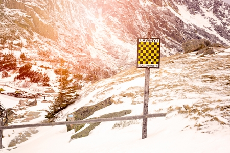 avalanche: Avalanche sign in winter mountains with snow. Polish inscription Avalanche Danger - Trail Closed