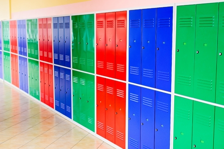 Colorful metal lockers installed in the hallway of the school.