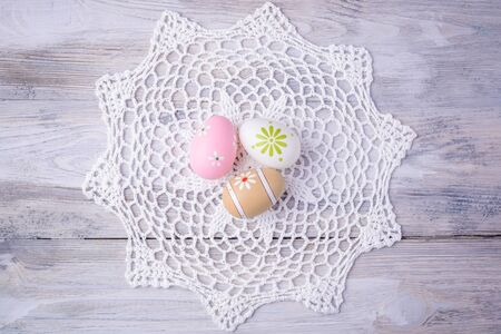 serviette: Colorful Easter eggs with white serviette on old cracked wooden background.  Easter concept. Happy Easter !