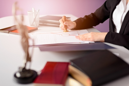 signing authority: Notary Public notarizes the document. Law office concept.