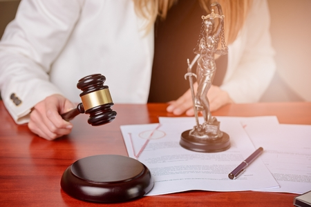 Woman holding judge gavel. Law Office Stock Photo - 53483556