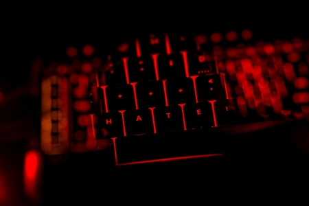 antisocial: Hate text on the illuminated buttons of the keyboard by night Stock Photo