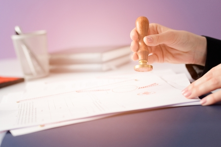 signing authority: Notary Public notarizes the contract in office Stock Photo