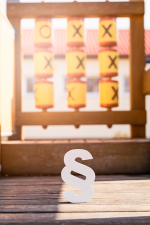 family law: White paragraph symbol on children playground. Family law or playground accident concept. Stock Photo