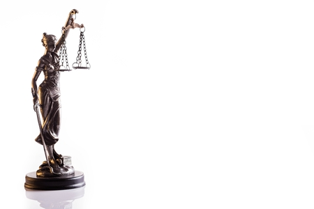 judicature: Statuette of the goddess of justice Themis with scales - isolated on white background. Law concept