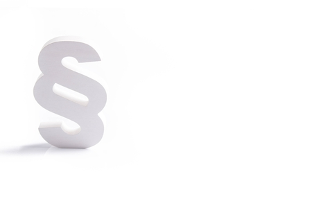 advocate symbol: White wooden paragraph the symbol of law - isolated on white background. Law concept Stock Photo
