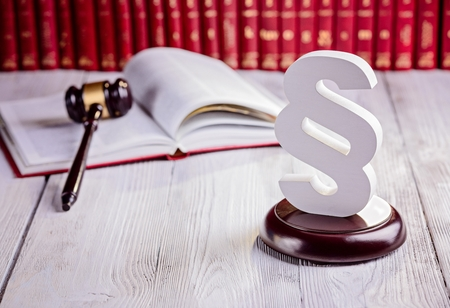 legislator: Symbols of law in court  library. Judge gavel, wooden paragraph and legal codes. Law concept Stock Photo