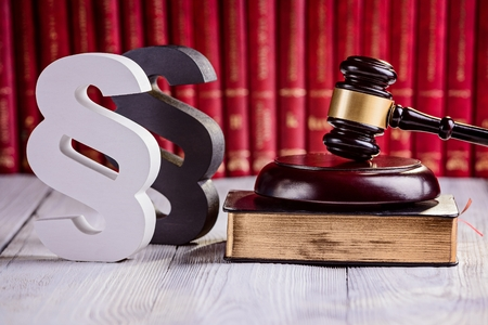 legality: Symbols of law in court  library. Judge gavel, wooden paragraph and legal codes. Law concept Stock Photo