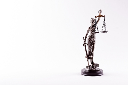 statuette: Themis - statuette of the Goddess of Justice isolated on white background