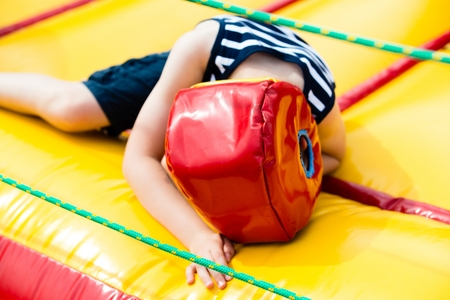 defeated: Defeated boy lying in a boxing helmet in the ring