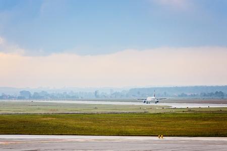taking off: Landing or taking off passenger airplane at airport