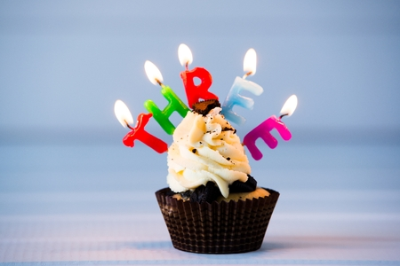 Birthdays cake - cupcake with a candles for 3 - third birthday . Happy birthday ! Stock Photo