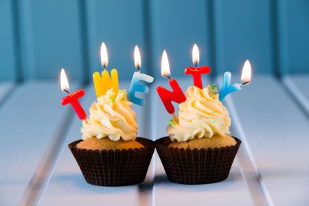 twentieth: Birthdays cake - muffin with a candles for 20 - twentieth birthday . Happy birthday ! Stock Photo