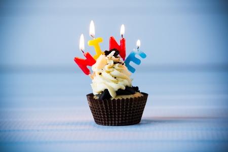 ninth: Birthdays cake - cupcake with a candles for 9 - ninth birthday . Happy birthday ! Stock Photo